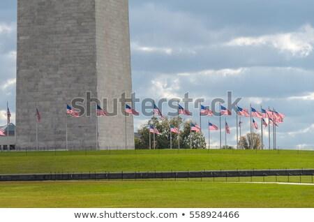 base washington monument surrounded american flags stock photo © qingwa