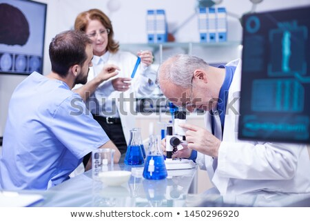 Doctor working in the lab Stock photo © Elnur