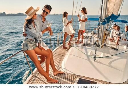 Kobieta żagiel łodzi szampana niebo wina Zdjęcia stock © IS2