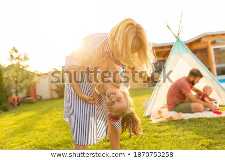 Fiú lány hordoz sátor család fű Stock fotó © IS2