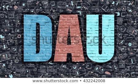 dau on dark brick wall stock photo © tashatuvango