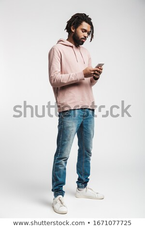 Serious concentrated young man standing isolated Stock photo © deandrobot