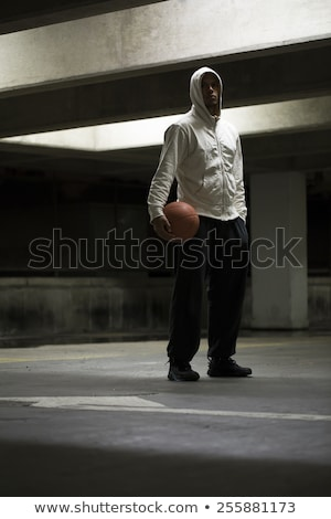 man holding basketball in car park Stock photo © IS2