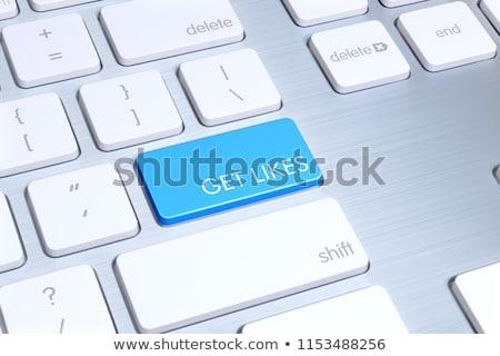 keyboard with blue key   get more likes stock photo © tashatuvango