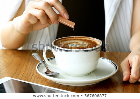 woman with coffee and sugar heart stock photo © is2