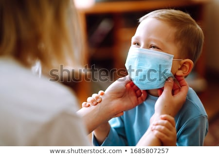 mother and children wearing masks stock photo © is2