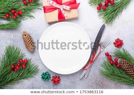 Christmas table place setting with decorations Stock photo © Melnyk