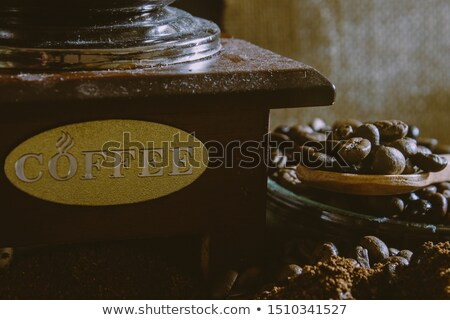 Old wooden coffee grinder with beans Stock photo © Melnyk
