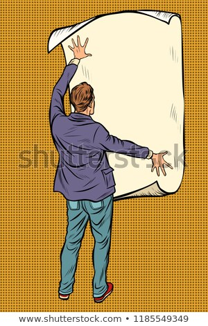 man unfolded poster paper, announcement on the wall Stock photo © studiostoks