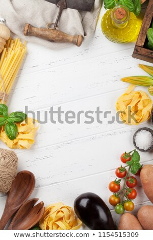 Fresh garden tomatoes, cucumbers and pasta on cooking table Stock photo © karandaev