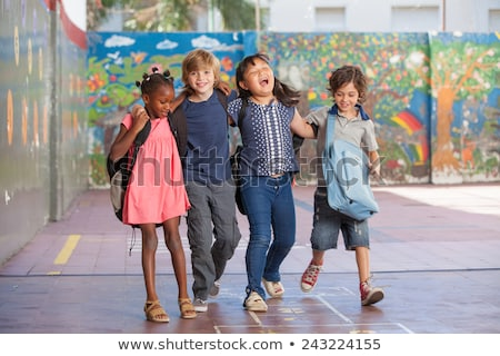Multi Ethnic and Diverse Students Playing in School Stock photo © artisticco
