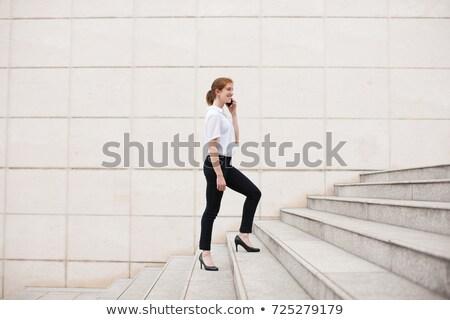 счастливым улыбающаяся женщина ходьбе наверх люди бизнеса Сток-фото © dolgachov