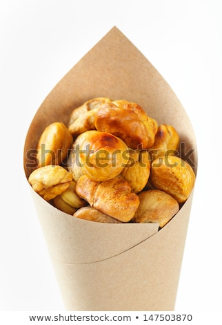 Roasted chestnuts in a paper cone Stock photo © homydesign