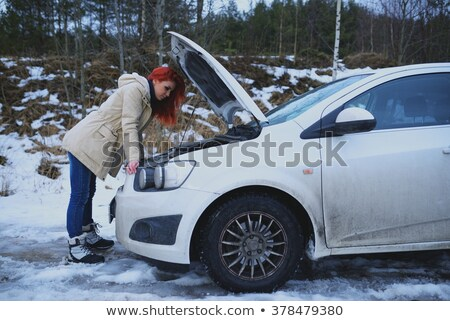 sad woman looking at broken down car engine stock photo © andreypopov