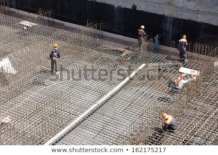 Construction worker making concrete foundation in formwork Stock photo © simazoran