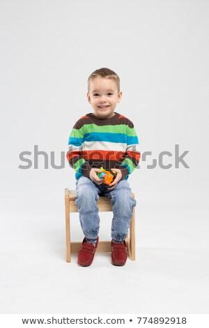 Little boy holding clapboard Stock photo © colematt