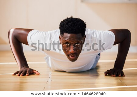 Foto stock: Adult Man Training Chest Muscles At Home Doing Push Ups
