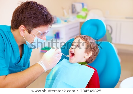 Stock photo: dentist checking for kid teeth at dental clinic