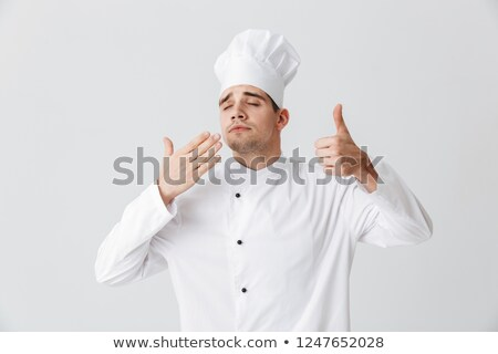 Cheerful chef cook wearing uniform tasting the smell Stock photo © deandrobot