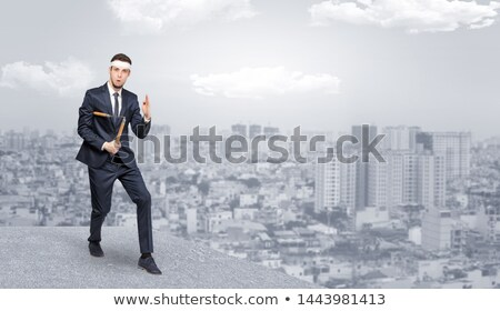 Suited karate man doing karate tricks Foto stock © ra2studio