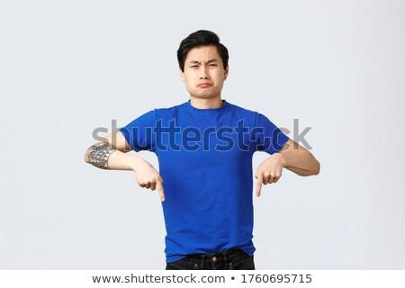 Portret teleurgesteld jonge asian man eten Stockfoto © deandrobot
