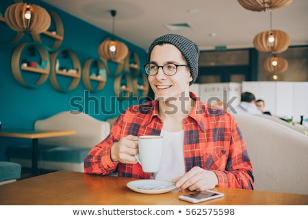 Man with cup of tea Stock photo © pressmaster