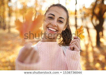 portrait of woman outdoors in autumn landscape stock photo © monkey_business