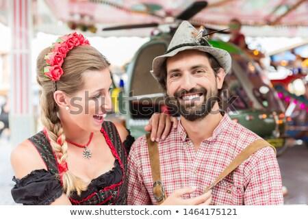 Couple visiting carrousel at the Oktoberfest in Bavaria Stock photo © Kzenon