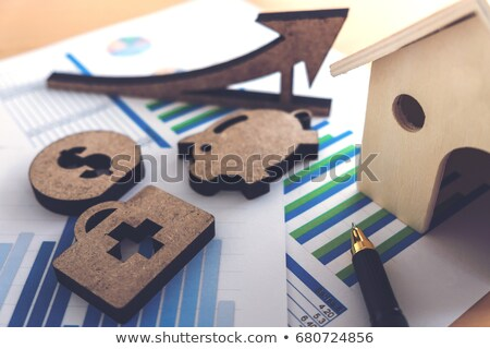 financial banking stock spreadsheet with stack of coin, house an Stock photo © Freedomz