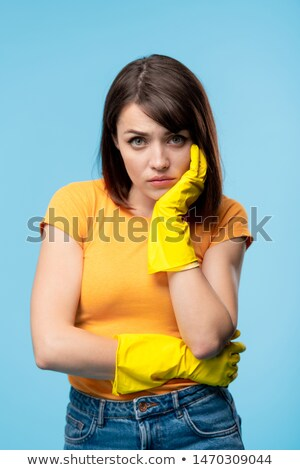 Young sick or upset female in yellow rubber gloves and t-shirt Stock photo © pressmaster