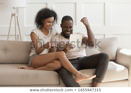Couple using new app on tablet Stock photo © pressmaster