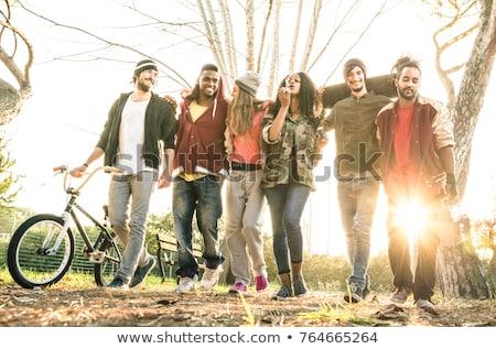Jeunes marche automne parc groupe Photo stock © boggy