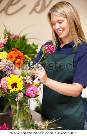 Florist  shop owner or customer outside with flower displays Stock photo © lovleah