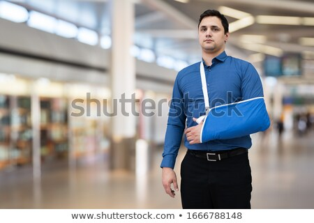 Man With Broken Arm In Airport Stock photo © AndreyPopov