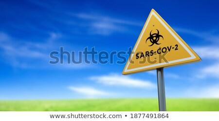 Bio-hazard Symbol With SARS-CoV-2 Coronaravirus Yellow Road Sign Stock photo © feverpitch