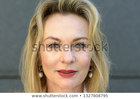 Attractive thoughtful woman wearing eye makeup Stock photo © Giulio_Fornasar