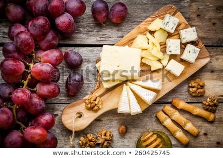 Cheese, grapes and nuts antipasto Stock photo © karandaev