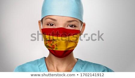 Espanha asiático médico bandeira espanhola imprimir máscara cirúrgica Foto stock © Maridav