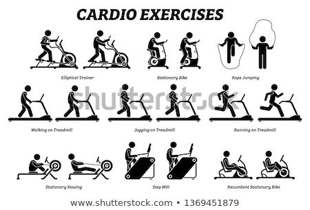 Man atleet opleiding cardio roeien machine Stockfoto © Maridav