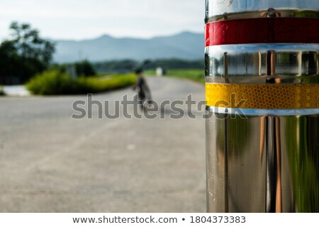 Red and blue bicycle reflector sign Stock photo © duoduo