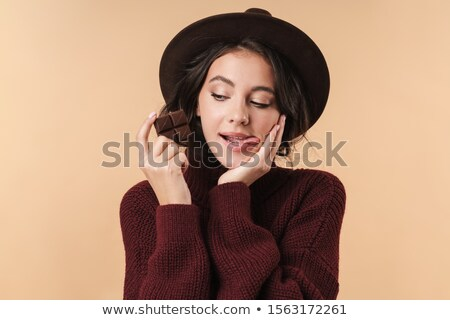 Pretty girl holding chocolate licking lips Stock photo © lovleah