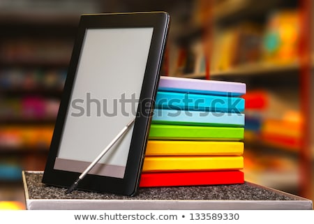 Stock photo: Row of colorful books with electronic book reader