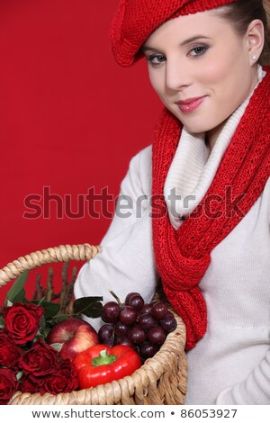 Woman in a red scarf and hat with red food and roses Stock photo © photography33