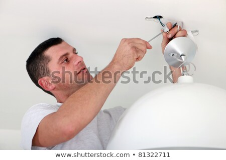 Handy-man fixing ceiling light Stock photo © photography33