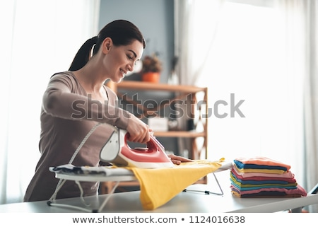 woman ironing Stock photo © smithore