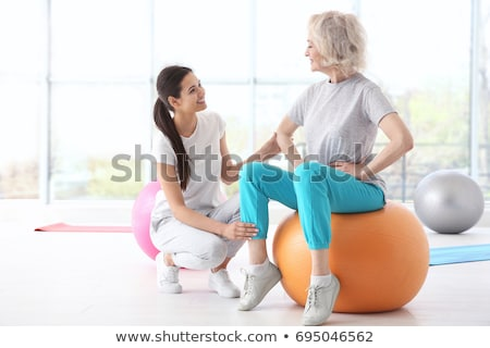 mature woman and physiotherapist Stock photo © photography33
