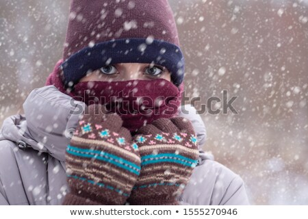 young woman freeze under falling snow stock photo © artjazz