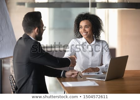 Stock photo: Confident modern businessman offering handshake