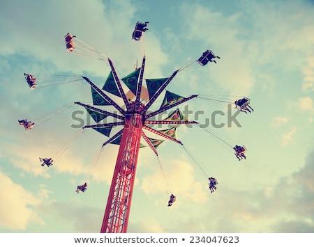 Ferris Wheel in motion glowing at night Stock photo © epstock