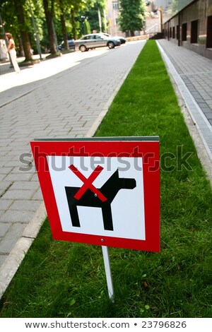sign meaning dogs are not allowed here stock photo © jakgree_inkliang